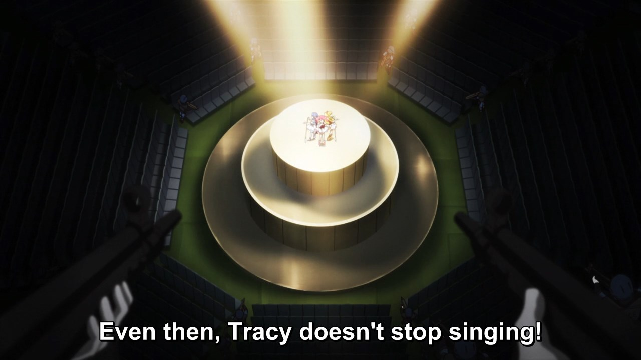 Even then, Tracy doesn't stop singing!